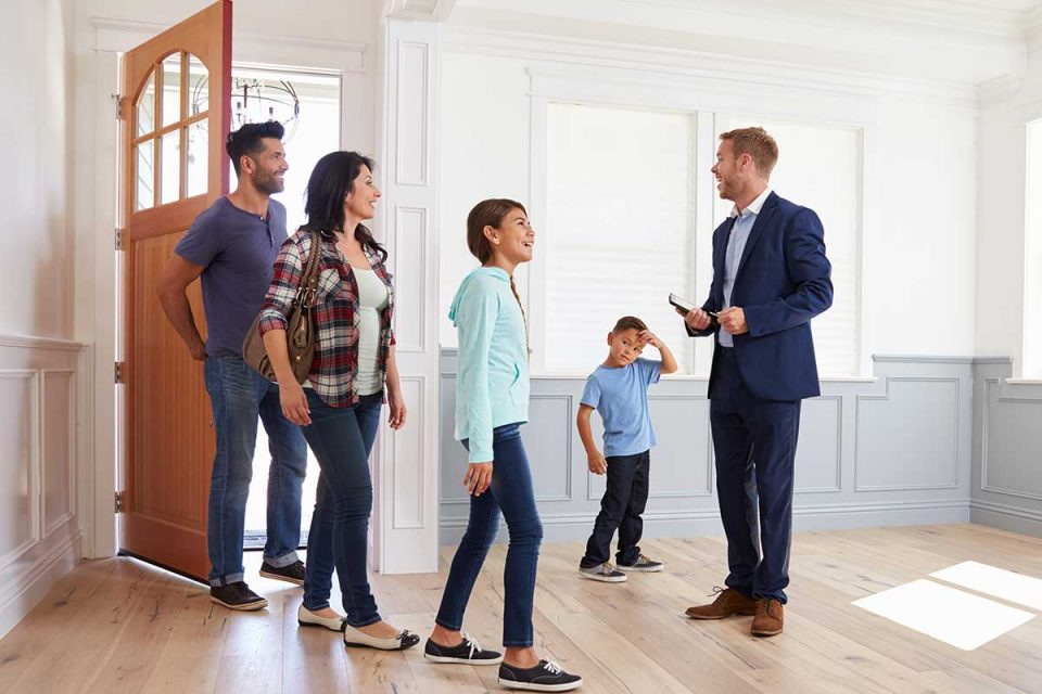 Realtor showing family a house